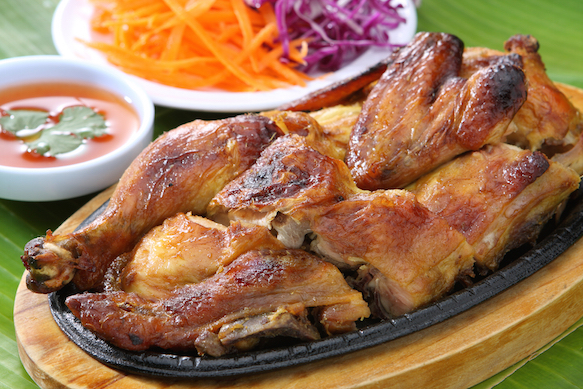 Grilled chicken with sticky rice (Khao Niew Gai Yarng)