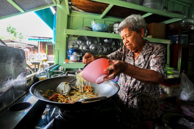 Meet the Local Expert Grandma or Amah cooking Pad Thai