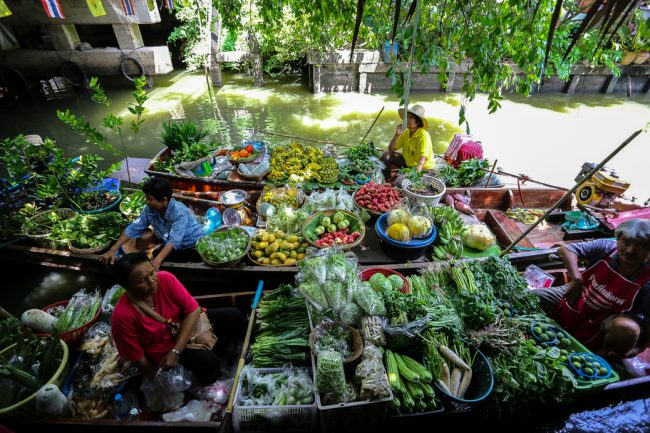 Meet the Local Expert Khun Maitree Boats filled with fresh product at Khlong Lat Mayom Floating Market