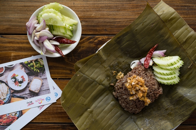 Weird Thai food: Khao Ngiao is served with garlic and vegetables and wrapped in banana leaf