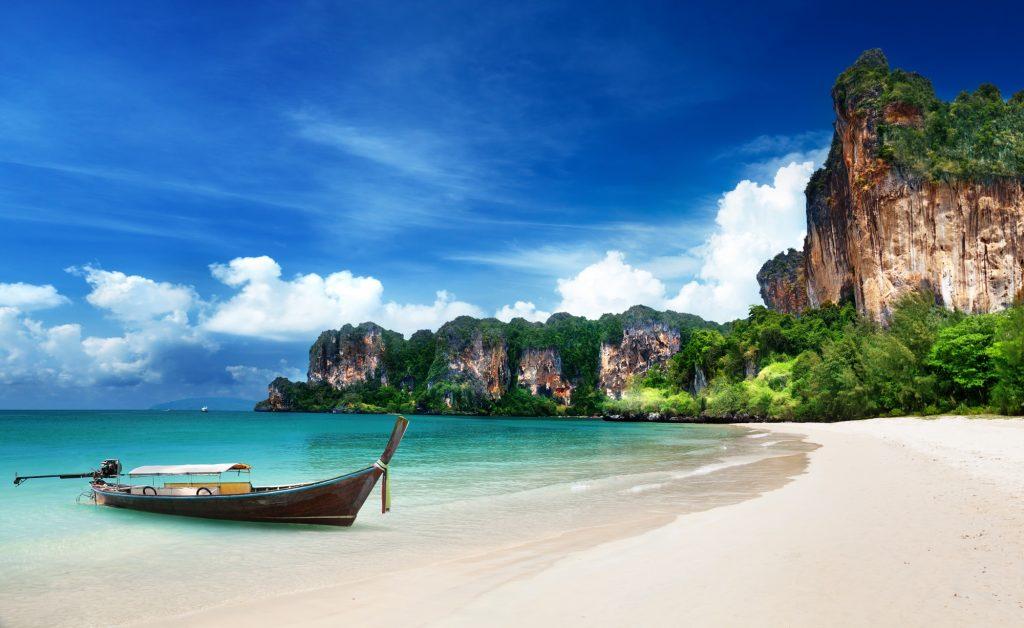 A long-tailed boat parks at Railay Beach, Krabi