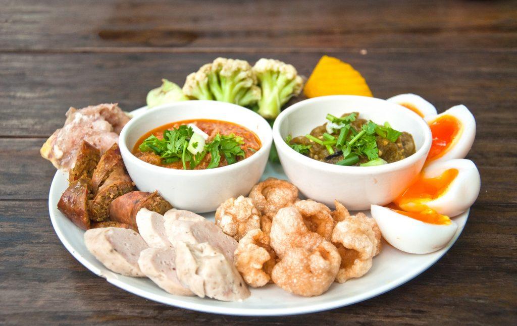 Nam Prik Noom, Nam Prik Ong, Nam Prik set, pork cracklings, sai ua, northern-style pork sausage, Chiang Rai food